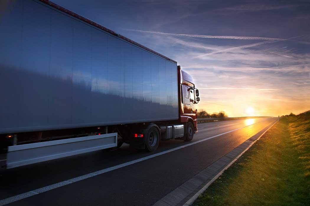 semi truck at sunset